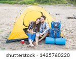 Stock photo people tourism and nature concept couple having fun on camping trip and play with cat 1425760220