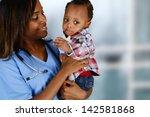 minority nurse working at her... | Shutterstock . vector #142581868