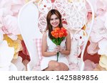 cheerful young woman holding... | Shutterstock . vector #1425889856
