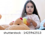 cheerful cute little girl with... | Shutterstock . vector #1425962513