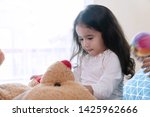 cheerful cute little girl... | Shutterstock . vector #1425962666