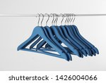 Stock photo metal rack with clothes hangers on white background 1426004066