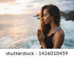 young woman praying and... | Shutterstock . vector #1426010459