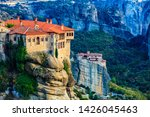 Holy Varlaam monastery on cliff in Meteora, Rousanou nunnery in the distance, Thessaly Greece. Greek destinations