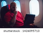 young man flight passenger... | Shutterstock . vector #1426095713