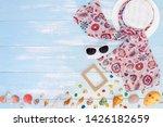 beach accessories on blue plank ... | Shutterstock . vector #1426182659