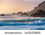 Breakers Roll In At Sunset On...