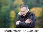Mature Man In Jacket Shivering...