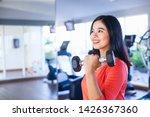 pretty indonesian woman lifting ... | Shutterstock . vector #1426367360