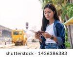 traveler young woman looking... | Shutterstock . vector #1426386383