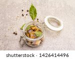 Stock photo slices of herring with spices in a glass jar mustard seeds bay leaf pepper mix healthy 1426414496