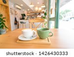 hot coffee on wooden table.   Shutterstock . vector #1426430333
