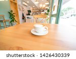 hot coffee on wooden table.   Shutterstock . vector #1426430339