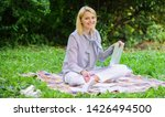 woman with laptop sit on rug... | Shutterstock . vector #1426494500