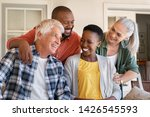 cheerful friends sitting in... | Shutterstock . vector #1426545593