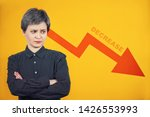Small photo of Confound businesswoman looking amazed aside pondering as income arrow graph is decreasing constantly. Business finance concept, money economy falling down. Crisis and bankrupt.