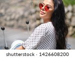young pretty woman smiling.... | Shutterstock . vector #1426608200