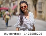 young pretty woman smiling.... | Shutterstock . vector #1426608203