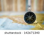 compass on the map and book in... | Shutterstock . vector #142671340