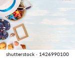 beach accessories on blue plank ... | Shutterstock . vector #1426990100