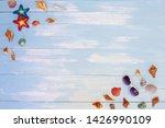 beach accessories on blue plank ... | Shutterstock . vector #1426990109