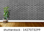 gray brick walls with wooden...   Shutterstock . vector #1427073299