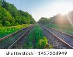 Railroad Tracks Stretching Int...