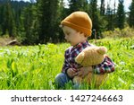 3 year old boy on the mountain... | Shutterstock . vector #1427246663