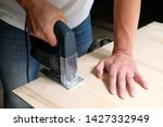 carpenter is sawing a plywood... | Shutterstock . vector #1427332949