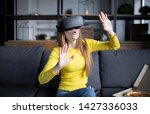 beautiful woman touching air... | Shutterstock . vector #1427336033