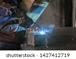 worker in a protective wardrobe ...   Shutterstock . vector #1427412719