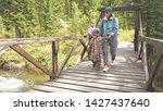 mother and son hiking in the... | Shutterstock . vector #1427437640