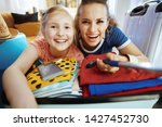 happy young mother and child in ...   Shutterstock . vector #1427452730