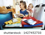 smiling modern mother and child ...   Shutterstock . vector #1427452733