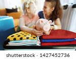 happy young mother and daughter ...   Shutterstock . vector #1427452736