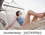 pretty woman blue swimsuit...   Shutterstock . vector #1427459363