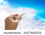 hand holding toy airplane...   Shutterstock . vector #1427460203