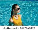 pretty woman swimming in the...   Shutterstock . vector #1427464889