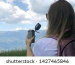 young woman traveler drinking...   Shutterstock . vector #1427465846