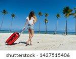 cute woman red suitcase beach...   Shutterstock . vector #1427515406