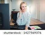 smiling young businesswoman... | Shutterstock . vector #1427569376