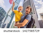 dad and son tourists in...   Shutterstock . vector #1427585729