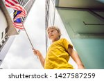 young boy tourist with the flag ...   Shutterstock . vector #1427587259