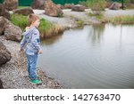 Cute Boy Playing With Stones...