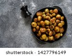 fried  young potatoes with... | Shutterstock . vector #1427796149