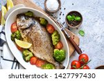 baked dorado with spices  with... | Shutterstock . vector #1427797430