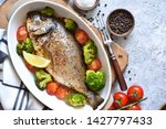 baked dorado with spices  with... | Shutterstock . vector #1427797433