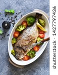 baked dorado with spices  with... | Shutterstock . vector #1427797436