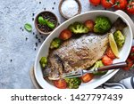 baked dorado with spices  with... | Shutterstock . vector #1427797439