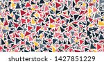 packed triangles confetti... | Shutterstock .eps vector #1427851229